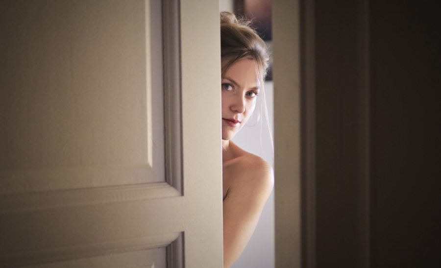 photo-of-woman-behind-door-1459558 (1)